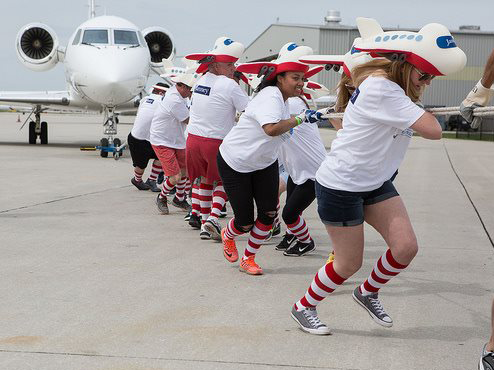 Team Janney pulls a plane to raise money.